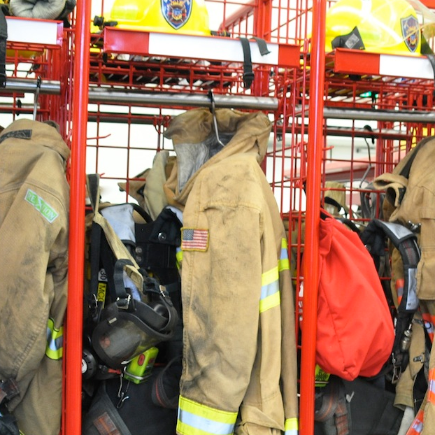 Firefighters equipment hung in locker.