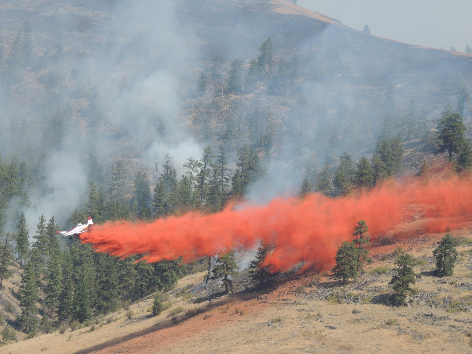 Airplane drops fire retardant on a 2012 fire in the Niobrara Valley